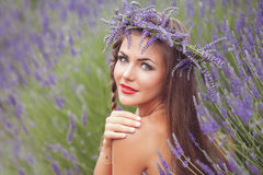 Portrait of beautiful woman in lavender wreath. outdoors Stock Photos