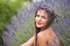 Portrait of beautiful woman in lavender wreath. outdoors Royalty Free Stock Photo