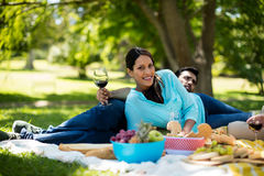 Portrait of beautiful woman leaning  on picnic blanket Royalty Free Stock Photography