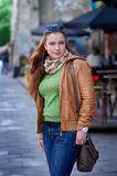 Portrait of beautiful woman with leather jacket in the city Royalty Free Stock Photography