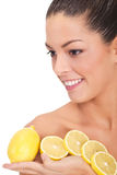 Portrait of a beautiful woman with lemon fruit Royalty Free Stock Photos