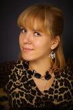 Portrait of beautiful woman in leopard dress Stock Image