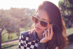Portrait of beautiful woman listening on mobile phone use for pe Royalty Free Stock Photography