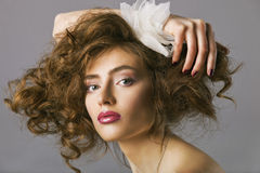 Portrait of a beautiful woman with long brown hair and makeup Royalty Free Stock Photos
