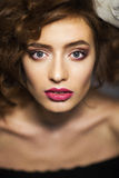 Portrait of a beautiful woman with long brown hair and makeup Stock Photos