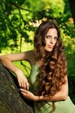 Portrait of beautiful woman with long curly hair Royalty Free Stock Photo