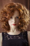 Portrait of beautiful woman with long curly red. Display languag Royalty Free Stock Photos