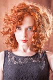 Portrait of beautiful woman with long curly red. Stock Photo