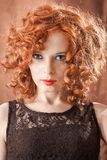 Portrait of beautiful woman with long curly red. Royalty Free Stock Photo