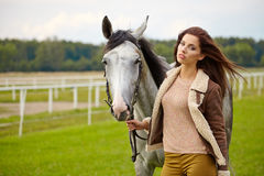 Portrait beautiful woman long hair next horse Royalty Free Stock Photography