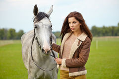 Portrait beautiful woman long hair next horse Royalty Free Stock Image