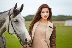 Portrait beautiful woman long hair next horse Royalty Free Stock Photo