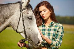 Portrait beautiful woman long hair next horse Stock Image