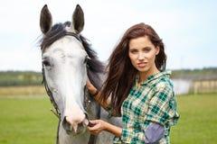 Portrait beautiful woman long hair next horse Stock Image