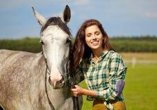 Portrait beautiful woman long hair next horse Stock Photo