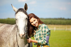 Portrait beautiful woman long hair next horse Royalty Free Stock Images