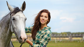 Portrait beautiful woman long hair next horse Stock Images