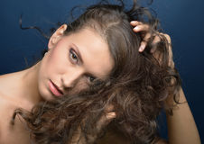 Portrait of the beautiful woman with long hair. Royalty Free Stock Photography