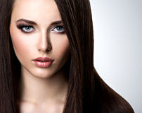 Portrait of beautiful woman with long straight brown hair Royalty Free Stock Photography