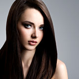 Portrait of beautiful woman with long straight brown hair. Portrait of beautiful young woman with long straight  hair at studio Royalty Free Stock Photos
