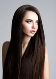 Portrait of beautiful woman with long straight brown hair Royalty Free Stock Images