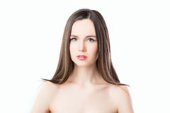 Portrait of a beautiful woman with long straight hair isolated on white background. Beauty, fashion, hair, makeup Royalty Free Stock Image