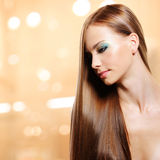 Portrait of beautiful woman with long straight hairs. And fashion makeup of eyes royalty free stock image