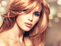 Portrait of a beautiful woman with long straight red hair. And glamour makeup. Closeup face of a art creative instgram background Stock Photo