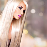 Portrait of  a  beautiful  woman with long white straight  hairs. Portrait of  a  beautiful adult woman with long white straight  hairs.  Face of a Fashion model Stock Photo