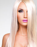 Portrait of  a  beautiful  woman with long white straight  hairs. Portrait of  a  beautiful adult woman with long white straight  hairs.  Face of a Fashion model Stock Images