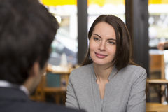 Portrait of beautiful woman during a lunch with a man in restaur Royalty Free Stock Photo