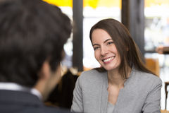 Portrait of beautiful woman during a lunch with a man in restaur Royalty Free Stock Photography