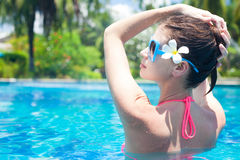 Portrait of beautiful woman in luxury pool Stock Images