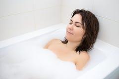 Portrait of beautiful woman lying in bath Royalty Free Stock Photos