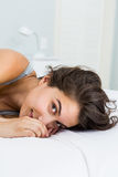 Portrait of beautiful woman lying on bed Stock Photos