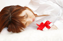 Portrait of beautiful woman lying with gift box Royalty Free Stock Images