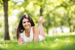 Portrait of beautiful woman lying on grassland Stock Photos