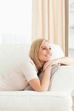 Portrait of a beautiful woman lying on her sofa Stock Images
