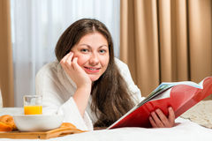 Portrait of a beautiful woman with a magazine Royalty Free Stock Image