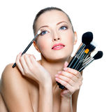 Portrait of beautiful woman with make-up brushes Stock Photo