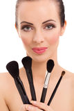Portrait of the beautiful woman with make-up brushes Stock Photos