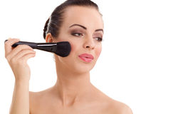 Portrait of the beautiful woman with make-up brushes Stock Photography