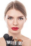 Portrait of the beautiful woman with make-up brushes Royalty Free Stock Photography