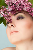 Portrait of beautiful woman with makeup and branch of lilac Stock Images