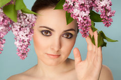 Portrait of beautiful woman with makeup and branch of lilac Stock Photo