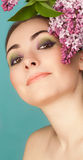 Portrait of beautiful woman with makeup and branch of lilac Royalty Free Stock Photography