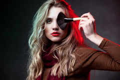 Portrait of beautiful woman with makeup brushes Royalty Free Stock Photos