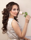 Portrait of beautiful woman with makeup and curly hairstyle Stock Image