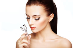 Portrait of beautiful woman making curl eyelashes Stock Photo