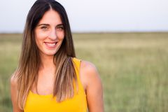 Portrait of beautiful woman in meadow Royalty Free Stock Photo